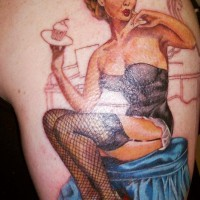 Pin up girl with cupcake tattoo by Ian Loughlin