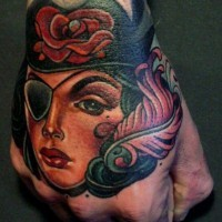 Pirate girl tattoo on hand by lars uwe