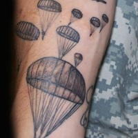 Planes and paratroopers tattoo on arm