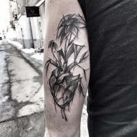 Plant shaped painted by Inez Janiak arm tattoo of human heart