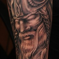 Portrait of harsh viking forearm tatoo