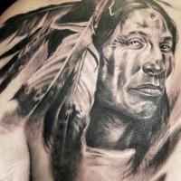 Portrait of native american tattoo on shoulder blade