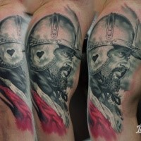 Portrait style colored biceps tattoo of medieval warrior with helmet