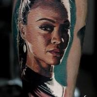 Portrait style colored leg tattoo of seductive Movie hero portrait