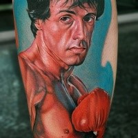 Portrait style colored leg tattoo of Rocky movie hero
