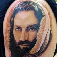 Portrait style colored shoulder tattoo of Jesus portrait