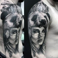 Portrait style colored shoulder tattoo of tribal woman with panda helmet