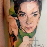 Portrait style colored thigh tattoo of woman face and swan
