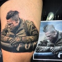 Portrait style colored thigh tattoo of Brad Pitt hero from Fury movie