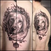 Portrait style detailed shoulder tattoo of sad dog face