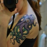 Purple green octopus tattoo on shoulder for girls
