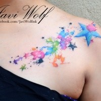 Rainbow colored stars with paint drips tattoo on chest and shoulder by Javi Wolf in watercolor style