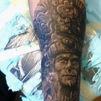 Real photo like black ink forearm tattoo of tribal priest portrait