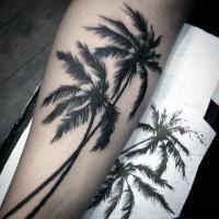 Real photo like black ink palm trees tattoo on arm