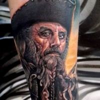 Real photo like colored creepy old pirate tattoo on arm