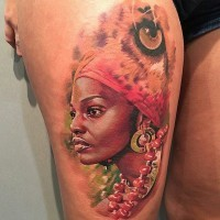 Real photo like colored thigh tattoo of tribal woman portrait on thigh
