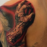 Real photo like magnificent colored shoulder tattoo of realistic zombie arm