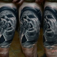 Real photo style black and white thigh tattoo of music singer