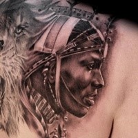 Realism style black and gray style back tattoo of tribal human with lion