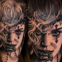 Realism style black ink thigh tattoo of creepy woman with cross and jewelry