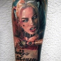 Realism style colored arm tattoo of crazy woman from famous movie