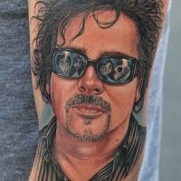 Realism style colored arm tattoo of man in sun glasses
