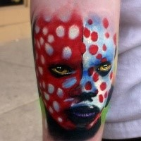 Realism style colored arm tattoo of tribal woman