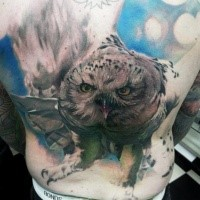 Realism style colored back tattoo of flying owl