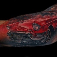 Realism style colored biceps tattoo of classic car