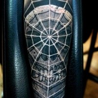 Realism style colored forearm tattoo of demonic skull with spider web
