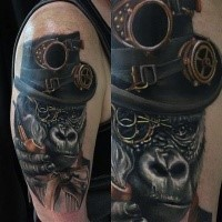 Realism style colored shoulder tattoo of gorilla with mechanical hat and smoking pipe