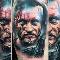 Realism style colored shoulder tattoo of bloody Viking TV serial hero portrait