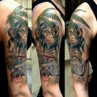 Realism style colored shoulder tattoo of monkey with palm tree and elephant