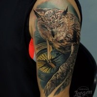 Realism style colored shoulder tattoo of owl with detailed compass