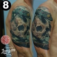 Realism style colored shoulder tattoo of human skull with lizard