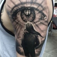 Realism style colored shoulder tattoo of human eye with woman figure