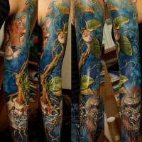 Realism style colored sleeve tattoo of big tree with gorilla face