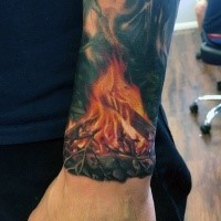Realism style colored small wrist tattoo of burning fire