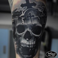 Realism style colored tattoo of creepy human skull with cemetery and cross