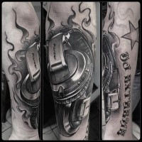 Realism style detailed arm tattoo of music headset with lettering