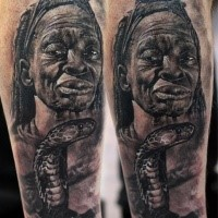 Realism style detailed arm tattoo of tribal woman with snake