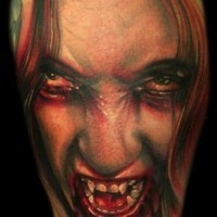 Realistic detailed and colored creepy bloody woman vampire tattoo on shoulder