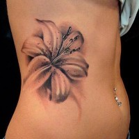 Realistic gray-ink lily flower tattoo on side