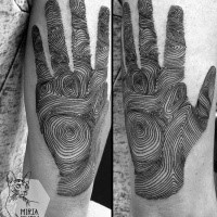 Realistic looking black ink arm tattoo of human hand with prints