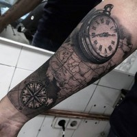 Realistic looking black ink clock with nautical world map tattoo on arm