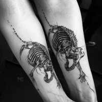 Realistic looking black ink forearm tattoo of cat skeleton by Inez Janiak