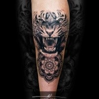 Realistic looking black ink tattoo of roaring tiger with ornamental flower