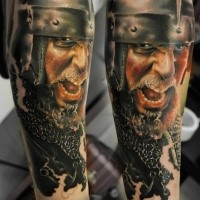 Realistic looking colored arm tattoo of medieval warrior