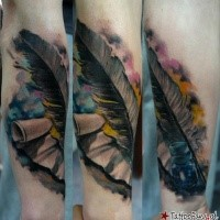 Realistic looking colored arm tattoo of paper with ink and feather