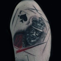 Realistic looking colored shoulder tattoo of king card